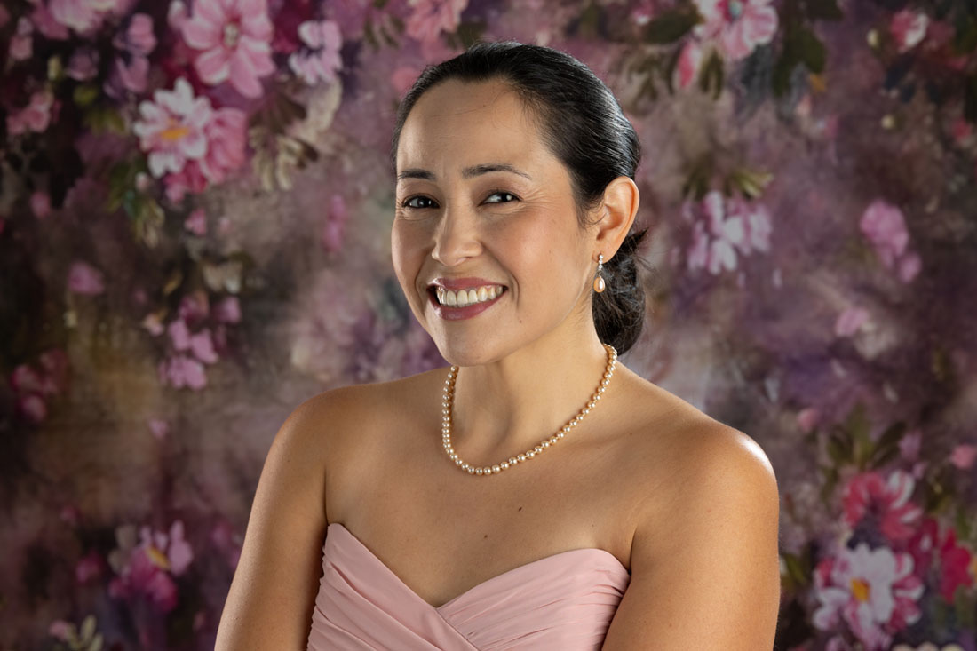 mother and daughters outdoor flowers portrait