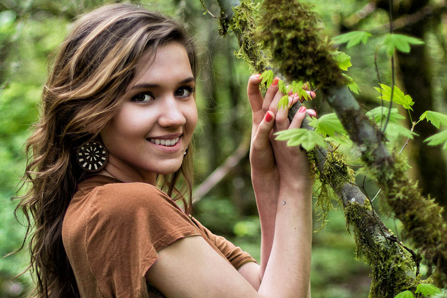 environmental portrait young woman smiling in nature