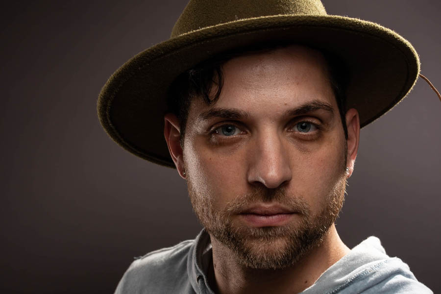 studio portrait by photographer mario vaden with hat and lights